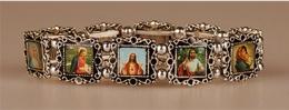 Helgon-armband i metall, silvrigt