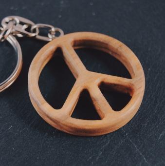 Fredsmärke i olivträ