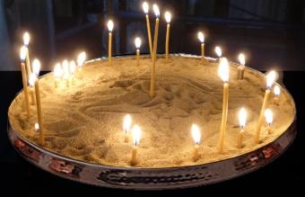 Sandbricka för vaxljus